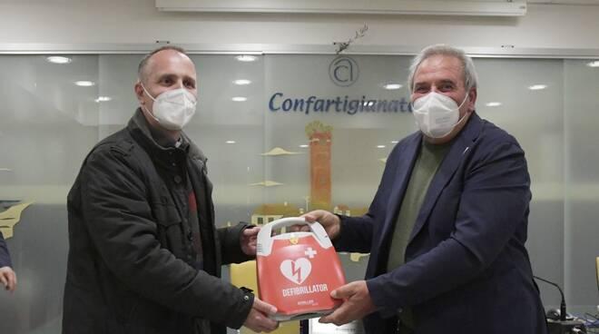 donazione defibrillatore Villaggio del Fanciullo consorzio Revision Art